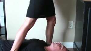 Awesome secretary wearing shoes sniffing in office
