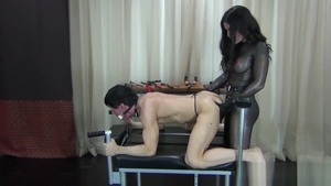 Strapon together with domme